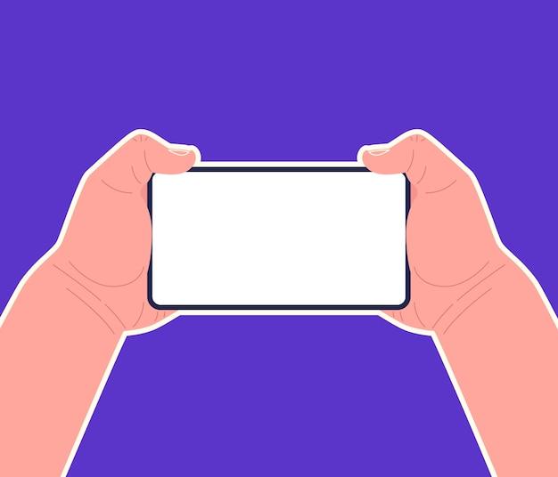 Due mani che tengono smartphone orizzontalmente.