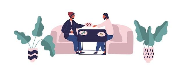 Un ragazzo di due hipster seduto al tavolo che mangia un pasto all'illustrazione piana di vettore di food court. amici maschi che si rilassano sul divano durante la cena o il pranzo isolati su sfondo bianco. persone che hanno una pausa al caffè.