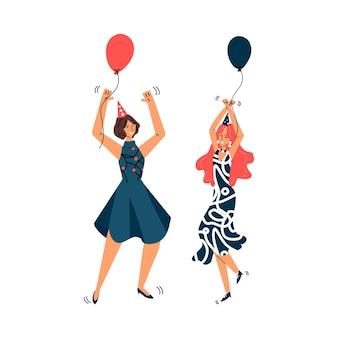 Due ragazze sorridenti in cappelli di compleanno festivi disegnano l'illustrazione vettoriale isolata