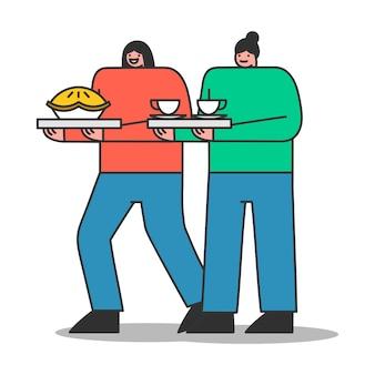 Due donne che servono tè o caffè e torta per i clienti del bar o gli amici che si incontrano