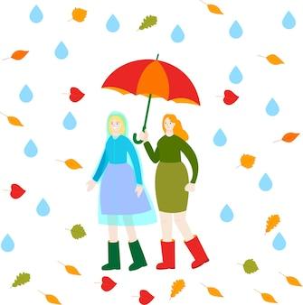Due donne camminano sotto la pioggia un'amica con un impermeabile un'altra con un ombrello autunno