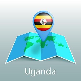 Mappa del mondo di bandiera dell'uganda nel perno con il nome del paese su sfondo grigio