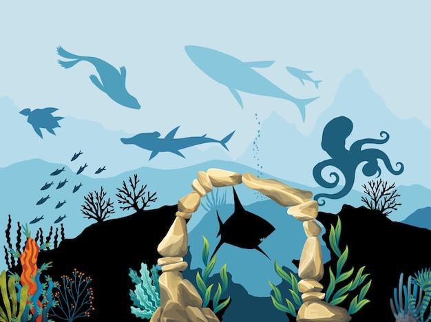 Fauna sottomarina. barriera corallina con pesci e arco in pietra su uno sfondo blu del mare.