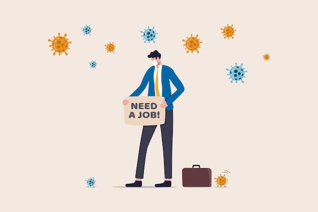 Disoccupazione, perdita di posti di lavoro a causa della crisi del coronavirus il blocco dell'epidemia covid-19 causa la chiusura della società e la chiusura degli affari, triste uomo d'affari senza lavoro con cartello scritto need a job with virus patogeno.