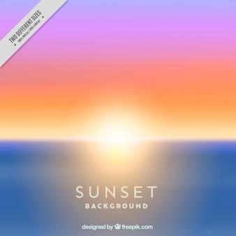 Sfondo unfocused del tramonto sulla spiaggia