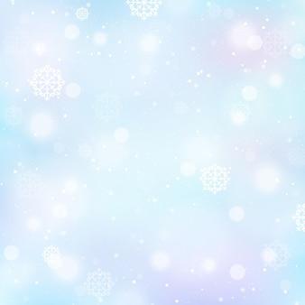 Sfondo invernale sfocato con fiocchi di neve