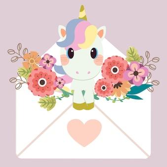 Unicorno seduto nella lettera con adesivo a cuore e fiore