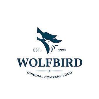 Logo unico con il concetto di una combinazione di una testa di lupo e una testa di uccello