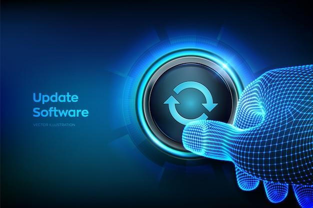 Pulsante di aggiornamento. dito del primo piano per premere un pulsante. aggiorna il concetto di versione del software. sincronizzazione e funzionamento tra dispositivi.