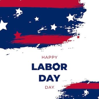 Cartolina d'auguri di usa labor day con priorità bassa del tratto di pennello nei colori della bandiera nazionale degli stati uniti e testo scritta a mano happy labor day