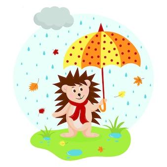 Ute riccio con un ombrello a pois su un prato sotto la pioggia