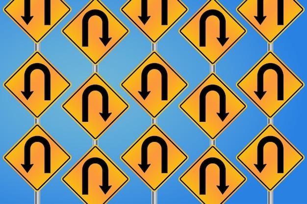 Segnali stradali di uturn sopra il fondo del cielo blu nella carta da parati senza cuciture del modello