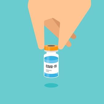 Vaccinazione covid19 concetto decorativo con la mano umana che tiene l'illustrazione piana di vettore di stile di progettazione del vaccino del coronavirus