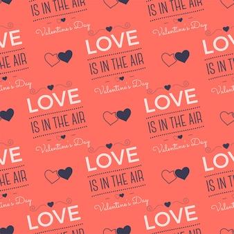 Modello di giorno di san valentino. l'amore è nelle citazioni e nei cuori della tipografia dell'aria. tavolozza dei colori di tendenza del corallo vivente 2019. design senza soluzione di continuità per le vacanze. per confezioni regalo, stampe tessili. vettore di riserva.