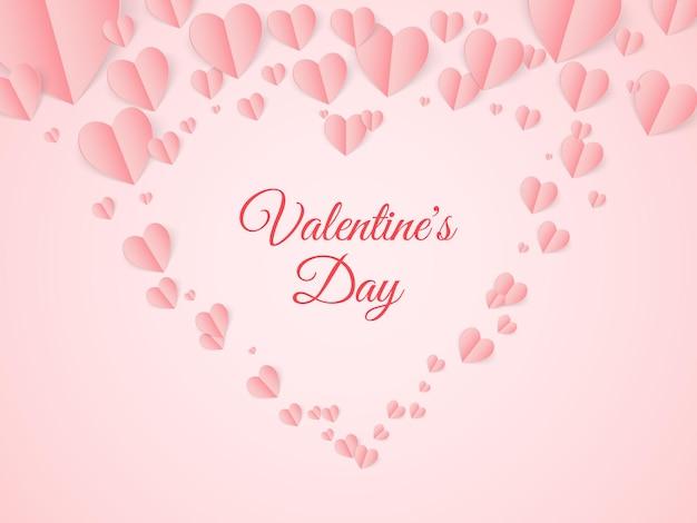 Cartolina di san valentino con cuori volanti di carta su sfondo rosa