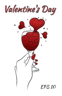 Carta di san valentino. mano femminile con un bicchiere di vino e fango a forma di cuori.