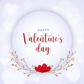 Carta di san valentino con cuori e rami dell'acquerello