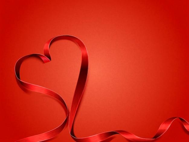 Concetto di san valentino, nastro a forma di cuore su sfondo rosso