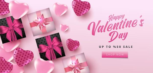 Poster di vendita di san valentino o banner con cuori e confezione regalo realistica su sfondo rosa tenue.