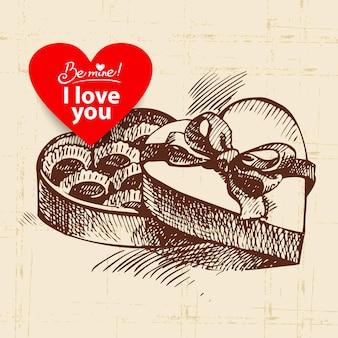 Sfondo vintage di san valentino. illustrazione disegnata a mano con banner a forma di cuore. scatola di cioccolato.