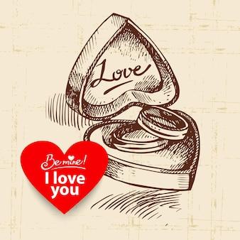 Sfondo vintage di san valentino. illustrazione disegnata a mano con banner a forma di cuore. scatola con fedi nuziali.