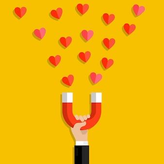 Illustrazione di san valentino. mano che tiene il magnete e attirare i cuori. design piatto, illustrazione vettoriale