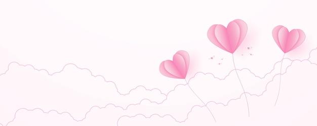Il giorno di san valentino amore concetto carta sfondo rosa palloncini a forma di cuore che galleggiano nel cielo
