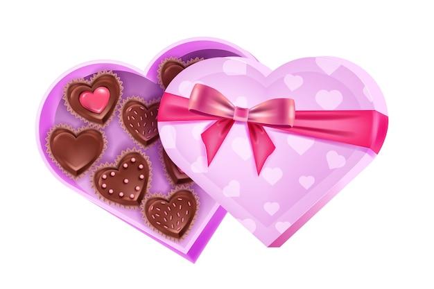La festa d'amore di san valentino ha aperto la scatola rosa a forma di cuore con caramelle al cioccolato, nastro, fiocco. illustrazione romantica sorpresa del dessert. caramelle di cioccolato presenti di festa isolate su priorità bassa bianca