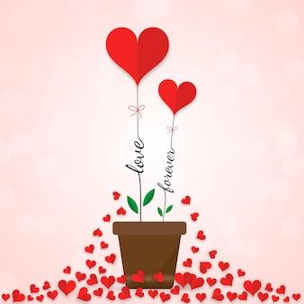 Elementi di taglio di carta cuori rossi di san valentino su sfondo rosa