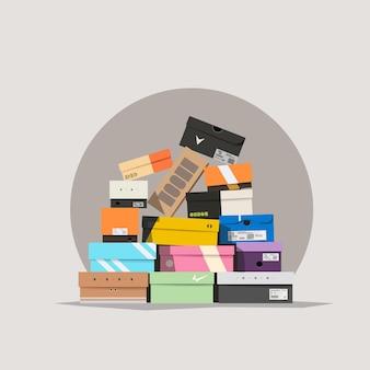 Varie scatole di scarpe che giacciono in una pila