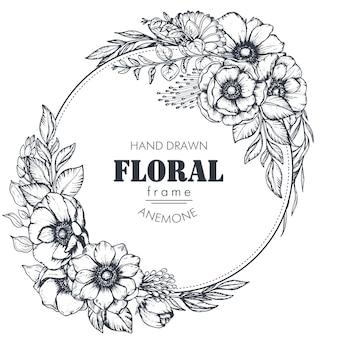 Cornice rotonda vettoriale in bianco e nero con mazzi di fiori di anemone disegnati a mano, boccioli e foglie in stile schizzo. bellissimo modello per inviti, biglietti di auguri.