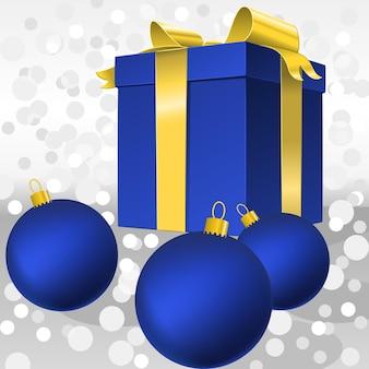 Confezione regalo blu vettoriale con fiocco in nastro dorato e palle di natale isolate su bianco