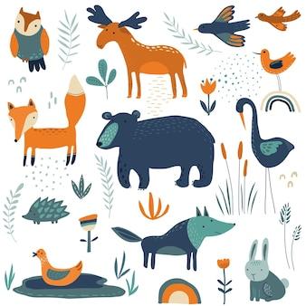 Raccolta vettoriale di fiori e piante di animali della foresta disegnati a mano