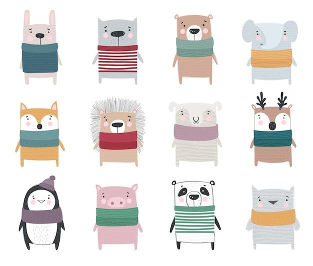 Collezione vettoriale di simpatici animali invernali con disegno a tratteggio in abiti accoglienti
