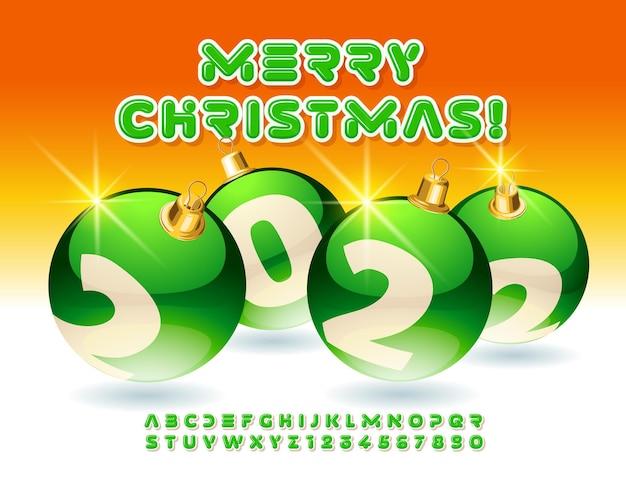 Biglietto di auguri decorativo vettoriale buon natale 2022 con palline decorate alfabeto verde e bianco