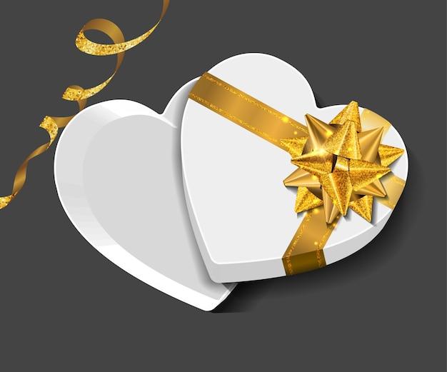 Vector confezione regalo con fiocco glitter dorato.