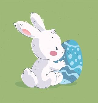 Illustrazione disegnata a mano di vettore con simpatico coniglietto e grande uovo di pasqua biglietto di congratulazioni di pasqua