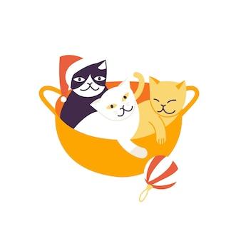 Illustrazione vettoriale simpatici gatti di natale seduti all'interno del cesto di starw e giocando con la palla di natale. atmosfera da vacanza invernale.