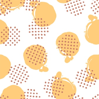 Pennello a pois disegnato a mano di reticolo senza giunte di vettore. fondo infinito astratto. la trama della vernice in colori pastello di giallo e marrone. illustrazione moderna per il design del tessuto e altro