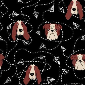 Reticolo senza giunte con basset hound bulldog e aeroplani di carta su sfondo nero