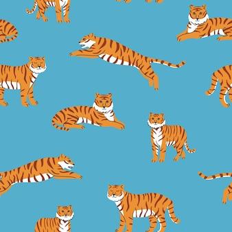 Reticolo senza giunte con tigri carine sullo sfondo blu spettacolo di animali da circo tiger year