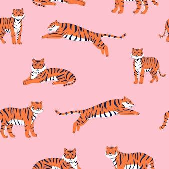 Modello vettoriale senza soluzione di continuità con tigri carine sullo sfondo rosa spettacolo di animali da circo tiger year