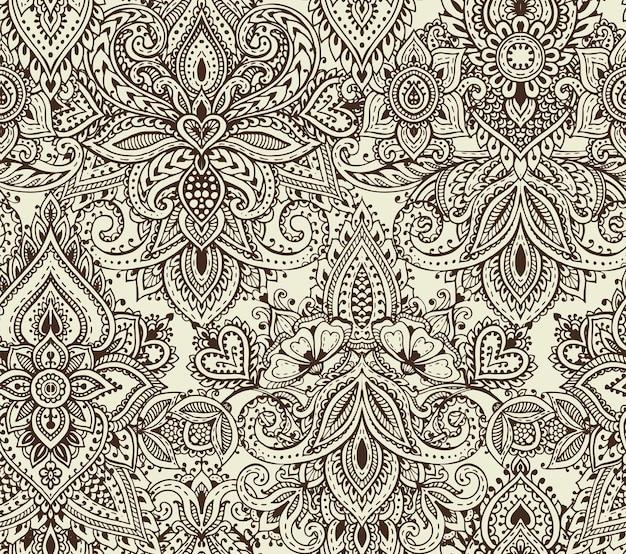 Reticolo senza giunte con elementi floreali mehndi hennè disegnati a mano. bellissimo sfondo infinito in stile indiano orientale
