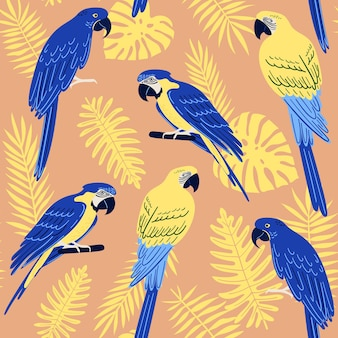Reticolo senza giunte con foglie di monstera tropicale, palma, felce e pappagalli: ara blu e oro e ara giacinto. illustrazione estiva