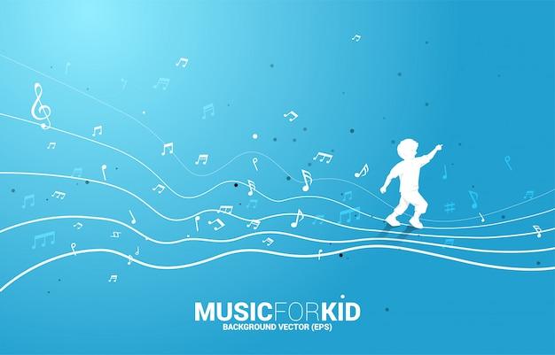 Vector la siluetta del bambino che funziona con la nota di musica di forma di flusso di dancing. musica per bambini e ragazzi.