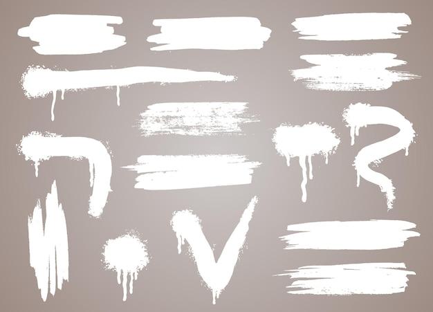 Forme di vernice spray vettoriale in bianco. modello di stencil per graffiti o strisce di vernice. linee astratte e gocce. schizzi per il tuo design.