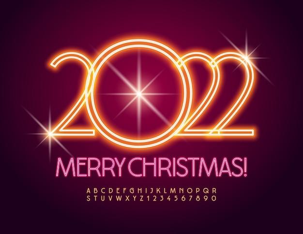 Elegante biglietto di auguri vettoriale buon natale 2022 set di alfabeto illuminato con carattere al neon luminoso