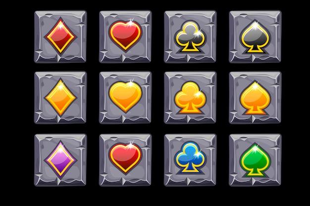 Simboli vettoriali carte da gioco sul quadrato di pietra. icone dei cartoni animati per casinò, slot, interfaccia utente. simboli su livelli separati.
