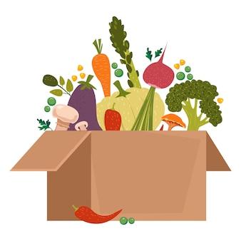 Verdure per vegetariani e amanti di uno stile di vita sano in una scatola di cartone