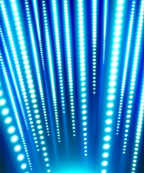 Strisce luminose a led verticali che brillano di blu e bianche abbaglianti sotto il blu scuro